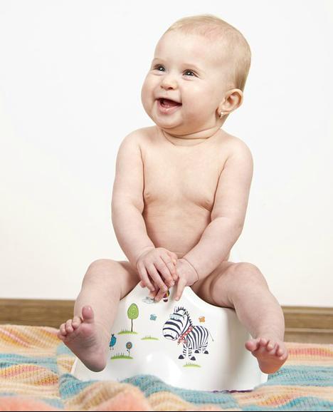 baby sitting on a potty